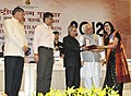 Pranab Mukherjee presenting the Rajat Kamal Award for Best Female Playback Singer Samhita (Marathi) for the Song Palken na Moondon, to Singer Aarti Anklekar Tikekar, at the 60th National Film Awards function.jpg