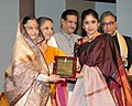 Pratibha Devisingh Patil presenting the Sangeet Natak Akademi Award-2009 to Ms. Ananda Shankar Jayant for her outstanding contribution to Bharatanatyam.jpg