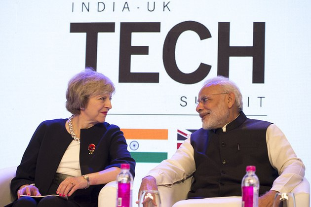 Prime Ministers Theresa May and Narendra Modi at the India-UK Tech Summit in India