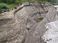 Pyroclastic Rock Layers of Shiveluch volcano in Kamchatka.jpg