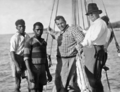Queensland State Archives 928 Messrs Davidson and Deering and two Black Boys from Lindeman Island who went spearing turtles c 1931.png
