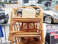 Rattan chair in outside of family store.jpg