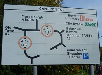 Cameron Toll - Road sign at Cameron Toll roundabout showing the low railway bridge crossing it at two points