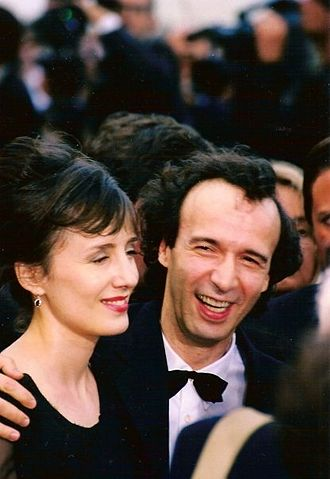 Life Is Beautiful - Roberto Benigni received positive reviews for his film and performance, which he starred in with his wife Nicoletta Braschi.