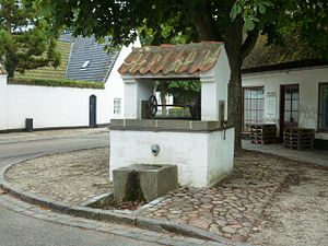 Søllerød - The old well next to the village pond. The current brick structure is from 1919