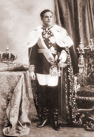 Portuguese Crown Jewels - King Manuel II, wearing the Mantle of Luís I, with the Crown of João VI.