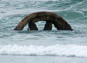 Victory Beach - Flywheel from the SS Victory, in the surf at low tide