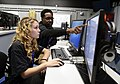 Sailor helps a high school student, complete cybersecurity challenges. (32378784741).jpg