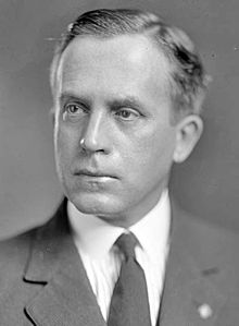 Upper-body portrait of a man in a suit.