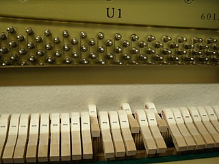 Mute (music) device fitted to a musical instrument to alter the sound produced