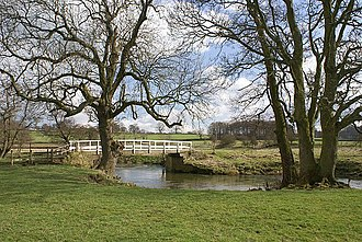 Snelston - Toadhole Foot Bridge - this crosses the River Dove as it meanders through its wide flood plain. Beyond the river is Staffordshire.