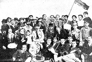 Constantin Mille - The Bucharest socialist circle in 1892. Mille, holding his two daughters in his lap, is third seated from the left in the second row; next in line, seated: Vasile Morţun and Constantin Dobrogeanu-Gherea. Artur Stavri is first seated from the left in the same row. Top row, standing, from the right: Ion Păun-Pincio (third), Henri Sanielevici (fourth), Simion Sanielevici (eighth).