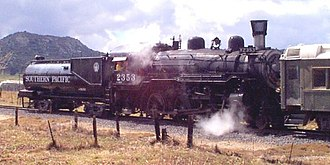 History of rail transportation in California - Restored Southern Pacific Lines No. 2353, a 4-6-0 oil-burning steam locomotive built by the Baldwin Locomotive Works in 1912. The cylindrical tender, specifically designed to carry fuel oil, was a signature feature of the railroad.