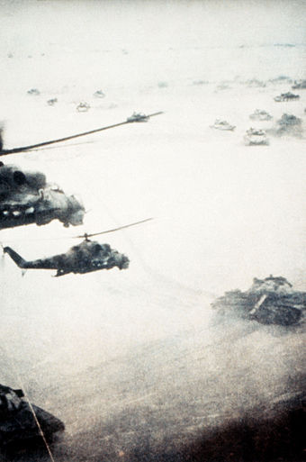 Soviet ground forces in action while conducting an offensive operation against the Islamist resistance, the Mujahideen. SovietafghanwarTanksHelicopters.jpg