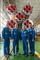 Soyuz MS-04 crew and backup crew in front of their booster rocket.jpg