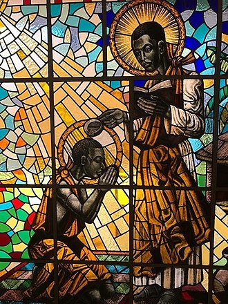 Charles Lwanga - St. Kizito being baptised by St. Charles Lwanga at Munyonyo - Stained glass at Munyonyo Martyrs Shrine''
