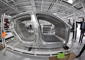 Tesla Factory - Stacked side panels that have been formed on the tandem press line.