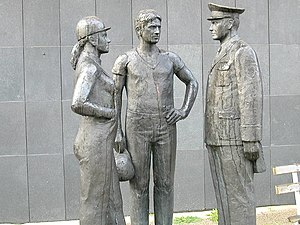 Statue of workers and Police officer in front ...