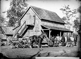 StateLibQld 1 134905 German immigrant family on their farm, probably in the Bethania area, Logan district, 1872.jpg