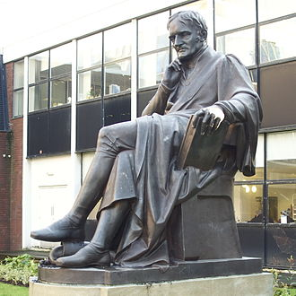 Manchester Metropolitan University - Statue of John Dalton by William Theed outside the university's building in Chester Street