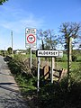Stile and Road Signs at Coddington - geograph.org.uk - 414551.jpg
