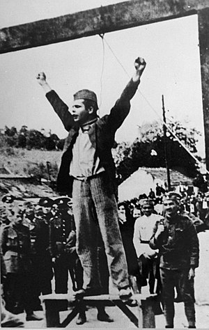 "Yugoslav Partisan fighter Stjepan ""Stevo"" Filipovic shouting ""Smrt fasizmu sloboda narodu!"" (""Death to fascism, freedom to the people!"") (the Partisan slogan) seconds before plunging to his death. Stjepan Stevo Filipovic.jpg"