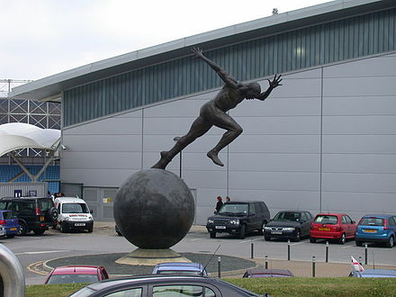 Colin Spofforth's giant bronze sculpture, The Runner, at SportCity Stop the world, I want to get off^ - geograph.org.uk - 732233.jpg