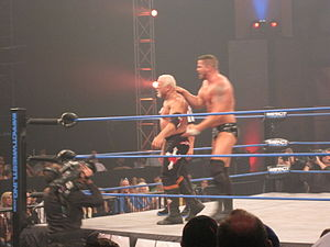 Chokeslam - Matt Morgan performing a reverse chokeslam on Scott Steiner