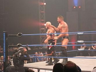 Chokeslam - Matt Morgan performing a reverse chokeslam on Scott Steiner