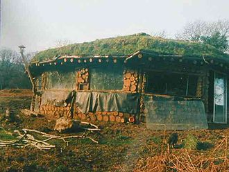 Cordwood construction - That Roundhouse was built in secret in the Pembrokeshire Coast National Park. The builders cut the timber themselves from the surrounding woods.
