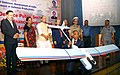 The CMD, Hindustan Aeronautics Limited (HAL), Shri T. Survarna Raju displaying a UAV as the Union Minister for Defence, Smt. Nirmala Sitharaman, the Union Home Minister, Shri Rajnath Singh, the Minister of State for Defence.jpg