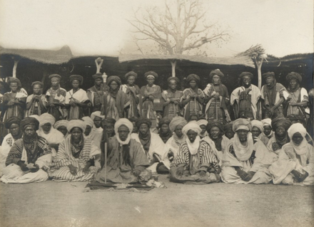 The Emir of Katsina, Muhammad Dikko dan Gidado, and other officials, 1911 The Emir of Katsena, Magagin on his right and district headmen, police in the background.png