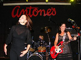 Belinda Carlisle, Kathy Valentine (right) and Gina Schock (back)