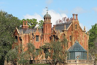 Haunted Mansion - The Magic Kingdom version features a Gothic revival-style.