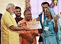 The Prime Minister, Shri Narendra Modi distributing the Sanction Letters to the identified beneficiaries of the Pradhan Mantri Awas Yojana (Rural), Rural at a function, in Lucknow, Uttar Pradesh.jpg