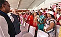 The Prime Minister, Shri Narendra Modi interacting with the participants of Hammar Chhattisgarh Yojana, at Naya Raipur, Chhattisgarh on November 01, 2016. The Chief Minister of Chhattisgarh, Dr. Raman Singh is also seen.jpg