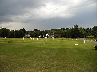 Tilford - Cricket on Tilford Green under threatening skies