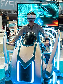 52ec51e58708 A man plays a virtual reality video game at Tokyo Game Show 2018