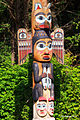 Totem Pole with Raven and his wife.JPG