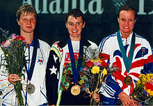 Tracey Cross 100m fly with other medallists.jpg
