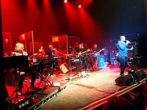 The Trevor Horn Band - The Trevor Horn Band performing on 5 March 2015 at the O2 Shepherds Bush Empire in London. L-R; Jamie Squire, Geoff Downes, Lol Crème (behind Downes), Ash Soan, Trevor Horn, Luis Jardim, Simon Bloor (behind Jardim), Steve Lipson, Julian Hinton, Phil Palmer, Seal (making an announcement). Not pictured Kirsten Joy, Kate Westall.