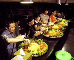 Tumpeng - Several nasi kuning tumpengs served during a feast.