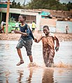Two boys playing in water.jpg