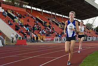 Gateshead International Stadium - Young athletes run past the Tyne and Wear stand at Gateshead International Stadium
