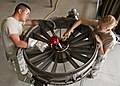 U.S. Air Force Airman Brandinn Kim, left, and Airman Elizabeth Ulring, both in the jet propulsion course with the 361st Training Squadron, ready a bearing housing on an F-15 Eagle aircraft engine for 130827-F-NS900-001.jpg
