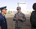U.S. Air Force Maj. Michael Simons, center, the lead planner of African Partnership Flight Mauritania, speaks with Republic of Tunisia Air Force Maj. Karim Boukara, left, an instructor pilot, and Republic 140901-F-FV908-002.jpg