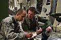 U.S. Air Force Staff Sgt. Joseph Araiza, left, a photojournalist with the 4th Combat Camera Squadron, interviews Staff Sgt. Michael Stevens, an aeromedical service journeyman with the 86th Aeromedical Evacuation 140313-F-RW714-217.jpg