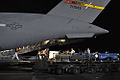 U.S. Airmen, Sailors and contractors unload dolphins assigned to the U.S. Navy Marine Mammals Program from a C-17 Globemaster III from March Air Reserve Base, Calif., at Hickam Air Force Base, Hawaii 091108-F-LX971-098.jpg