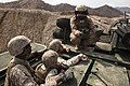 U.S. Marine Corps Lance Cpl. David N. Scott, top, a crew chief with Combat Assault Battalion, III Marine Expeditionary Force, instructs Marines with the 3rd Battalion, 12th Marine Regiment on the operation 140327-M-MO123-085.jpg