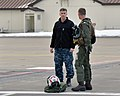 U.S. Navy Capt. Chris Rodeman, left, the commanding officer of Naval Air Facility (NAF) Misawa, greets Cmdr. William McCombs, the commanding officer of Electronic Attack Squadron (VAQ) 132, after the squadron 140227-N-DP652-027.jpg